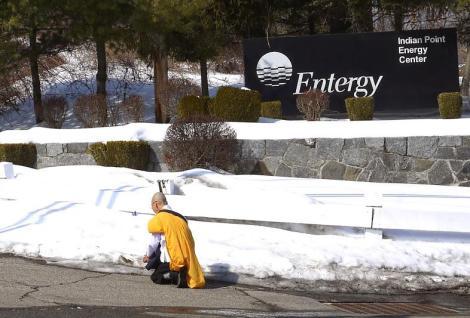 Jun-san offering prayer, placing peace crane at Indian Point