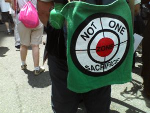 "Green cloth with a scope target on it that says ""Not One Sacrifice"" and the word ""Zone"" in the center."