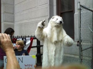 A mascot in a polar bear costume at the rally.